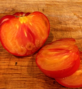 The gorgeous colors of a Mr Stripey heirloom tomato!