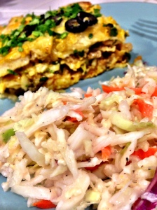 Close up of coleslaw and piece in back