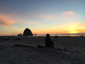 Beth enjoying an amazing New Year sunset over Haystack rock.